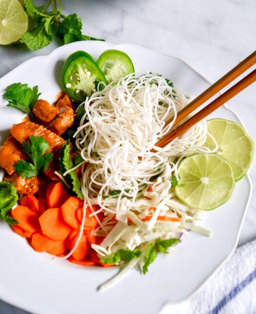Vietnamese noodle bowls with chopsticks twirling noodles