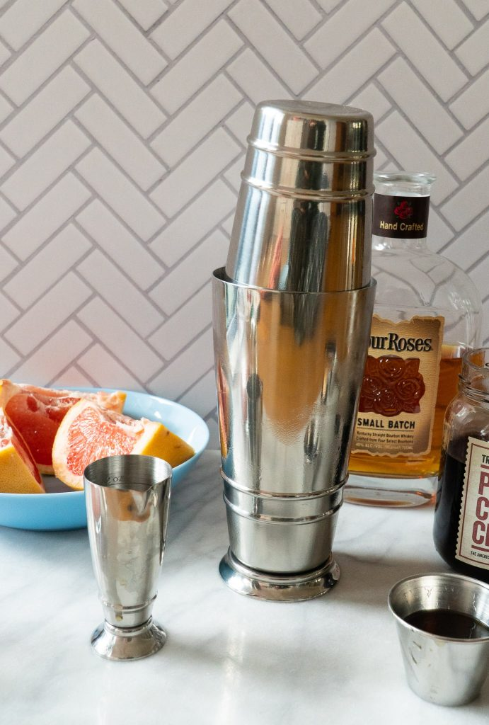 Cocktail shaker with bourbon and grapefruit
